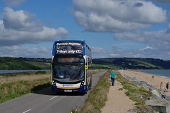 Passing The Strollers of Slapton Sands (Better Living Through Chemistry37) Tags: route3 stagecoach stagecoachdevon stagecoachsouthwest sn65nzk 10495 alexanderdennis e40d enviro enviro400 enviro400mmc torcross slapton slaptonsands a379 buses busesuk busessouthwest vehicles vehicle transport transportation psv publictransport