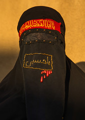 Portrait of an iranian shiite muslim woman with her face hidden by a veil mourning imam hussein on tasua during the chehel manbar ceremony one day before ashura, Lorestan province, Khorramabad, Iran (Eric Lafforgue) Tags: 1people 30s adult adultsonly ashura celebration ceremony chador chehelmanbar clothing colorimage covered female hidden hussain imamhussein iran islam khorramabad lookingatcamera memorialevent middleeast mourner mourning muharram muslim mysterious niqab oneperson onewomanonly outdoors people persia portrait religion religious ritual script shia shiism shiite tasoua tasua unrecognizableperson veiled vertical woman lorestanprovince ir