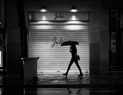 Julia (yanngemini) Tags: street madrid rain umbrella argüelles