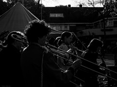 The band played on and on (Harry -[ The Travel ]- Marmot) Tags: holland nederland netherlands dutch hollands nl amsterdam mokum stadsarchief stad city urban stedelijk stads zonneplein tuindorpoostzaan amsterdamnoord noord human portret portrait allrightsreservedcontactmebyflickrmail zwartwit blackandwhite bw monochroom monochrome schwarzweis toetersenbellen band brass fanfare muzikanten music women trombone
