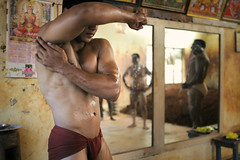 Indian mud wrestlers (slow paths images) Tags: travel school india man sports muscles wall training exercise body indian mirrors tradition karnataka mysore reflexion fit southindia southasia akhara kushti indiansubcontinent kusti fredcan indianmudwrestler