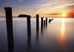 Making The Most of The Posts.  {Explored} (Pixelsuzy) Tags: blue sunset west beach bay mare down super le hour sunburst posts uphill brean pixelsuzy