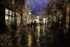 A rainy night in Arnhem! (janetmeehan) Tags: street people holland colour netherlands rain night reflections candid arnhem streetscene rainy raindrops