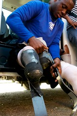 Blake dons his blades (JP Theberge) Tags: art haiti amputees challengedathletes