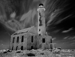 Pharos (explored) (Robert-Jan van Lotringen) Tags: longexposure light lighthouse white black building heritage abandoned clouds island mono pov ghost ruin spirits spooky explore curacao nd mysterious caribbean ghostly deserted vuurtoren sentinel pharos flickrexplore dutchantilles atmophere kleincuracao bestcapturesaoi elitegalleryaoi
