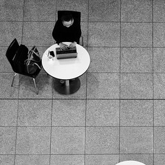 """""""Working in Space"""" (helmet13) Tags: leicaxvario bw snapshot woman table laptop purse coffee cellphone pen cigarettes airport aoi chair heartaward peaceaward 100faves world100f simplicity"""