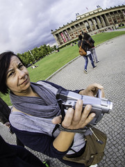 Woman with Video Camera (kohlmann.sascha) Tags: street people woman berlin lens deutschland photography donna fotografie place candid femme mulher streetphotography streetportrait technik olympus menschen fisheye altesmuseum frau technique mitte ort museumsinsel mensch thema lustgarten candidportrait berlinmitte 女人 objektiv pleasuregarden museumisland altemuseum oldmuseum 女子 streetfotografie laseñora strasenfotografie же́нщина фра́у bodycap9mm18 olympusbodycap9mm18 strasenfotografiemitfisheye streetwithfisheye v325040bw000