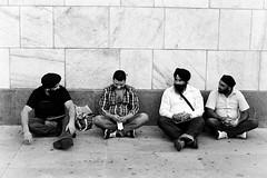 chat time / koyu sohbet (berkiybar) Tags: street bw italy man black milan monochrome beard photography chat fuji candid milano talk beyaz bnw sokak italya sakal siyah sohbet