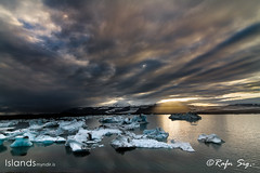 Icebergs on a lake in the twilight