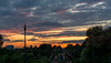 sunset 9-9-14 (d5e) Tags: above city pink trees sunset summer sky orange clouds 50mm golden tracks end bluehour streaks potsdam strips reddish skypainting d7100