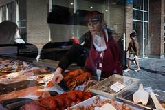 Fish shopping (paul indigo) Tags: fish reflection shop belgium oostende fishmonger paulindigo