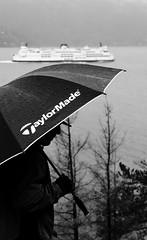 The Umbrella Man (korisidaway) Tags: westcoast bc taylormade korisidaway vancouver portrait outdoorportrait shadows backlight
