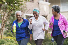 Three senior black women exercising together (UICmedia) Tags: women fitness exercising africanethnicity senioradult waterbottle walking losingweight outdoors casual springtime sportsclothing healthylifestyle active lifestyle trees houses neighborhood residential sidewalk buildings threepeople womenonly seniorwomen seniorwomanonly maturewomen female africandescent minority ethnic groupofpeople smallgroupofpeople 60s 6065years adult adultsonly whitehair friends girlfriends matureadult activeseniors retirement smiling happy laughing fun powerwalking jogging running lookingaway portrait threequarterlength realpeople candid photography colorimage people horizontal sc0715