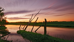 river in flood (wingers5) Tags: clouds landscape longexposure reflections river sunset water