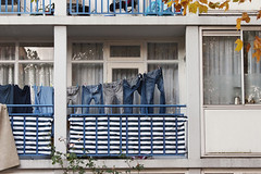The Blues (Arne Kuilman) Tags: canon 300d digital 70300 ef amsterdam nederland netherlands street straat walkaround nieuwwest jeans clothes kleren drying balcon balcony pants broeken was laundry broek blue blauw