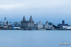 View of Liverpool at dusk (wells117) Tags: 700d acrossriver canon cathedral city clivewells dock lights liverbuiling liverpool mersey merseyside night nightview river threegraces twocathedrals water waterfront birkenhead england unitedkingdom