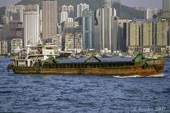 Small Cargo Vessel in Victoria Harbor (Greatest Paka Photography) Tags: boat harbor victoriaharbor china far east fareast port hongkong kowloon ship vessel southchinasea city skyline