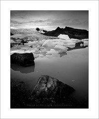 Particle XVII (Frank Hoogeboom) Tags: fjallsarlon ijsland blackandwhite monochrome iceland scandinavia glacier glacierlake lake ice cold freezing water clouds rock photography fineart