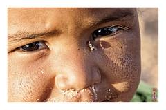 fly (alamond) Tags: child fly face eye shine tuareg algeria tamanrasset sahara desert shadow sun sunshine evening look canon 40d tamron 18270 brane zalar alamond