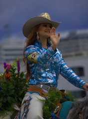 Waving To The Crowds (swong95765) Tags: woman horse rider riding wave waving cowgirl parade roses hat