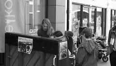 Playing together (Wookiee!) Tags: candid streetphotography straatfotografie people mensen city stad nijmegen 024 gelderland the netherlands dutch nl holland nederland nederlands zwartwit blackandwhite noiretblanc schwarzweis bw monochrome zw piano music muziek kunst art canon d550 dslr 35mm lens rhea elise wwwgevoeligeplatennl
