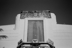 Cameo Theater (Phillip Pessar) Tags: from camera bw white cinema black film beach analog 35mm store theater theatre florida zoom kodak miami infinity tx south trix olympus x thrift 400 cameo tri 70 sobe