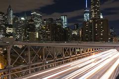 Brooklyn Bridge Traffic at Night (SamuelWalters74) Tags: newyorkcity manhattan worldtradecenter financialdistrict brooklynbridge worldfinancialcenter lowermanhattan woolworthbuilding freedomtower 1worldtradecenter beekmantower 1wtc oneworldtradecenter