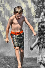 park boy sun wet water fountain speed jets young fast bubbles running charge