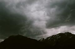 Storm Clouds above Tetons (Rachael.Robinson) Tags: park light storm mountains color film nature clouds dark hole snowy wildlife dramatic stormy jackson national wyoming teton tetons jacksonhole
