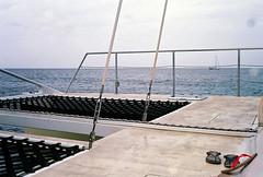 A catamaran. (jchal) Tags: ocean film water dutch analog canon boat klein kodak overcast rangefinder adventure flip curacao catamaran netherland flops portra canonet ql17 antilles 160