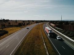 View from a bridge (Jennifer Lea) Tags: road bridge light sky cars look field wonder drive freeway trucks