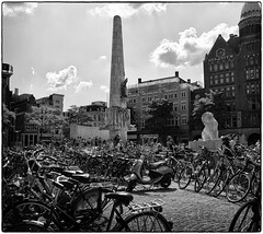 Many bikes on Dam square -  Amsterdam (vrijstaat) Tags: street people bw holland blancoynegro netherlands monochrome amsterdam photography dam candid nederland streetphotography bikes bn zwart wit mokum fiets straatfotografie powershotg1x