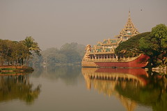 Gold in the Mist  [Explored] (The Spirit of the World ( On and Off)) Tags: mist lake water fog reflections gold asia day yangon burma atmosphere myanmar rangoon waterscape waterreflections royalbarge rememberthatmomentlevel4 rememberthatmomentlevel1 rememberthatmomentlevel2 rememberthatmomentlevel3 goldenasia