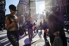 West 32nd street (stejo) Tags: street shadow woman sun newyork sunglasses backlight gold voigtlander streetphotography cellphone trousers zebracrossing west32ndstreet ilobsterit