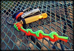 Mandala knot paracord keyfob (Stormdrane) Tags: paracord 550cord neon green orange stormdrane mandala trueloversknot flashlight led leatherman squirt multitool keys keychain keyring keyfob lanyard decorative useful grip retention thrunite hobby craft howto make tie braid weave design utility twostrand wallknot snakeknot scouting project gift knife zipperpull