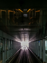 The Dark Light (yousufkurniawan) Tags: railway tunnel dark darkness light architecture reflection pillar abstract line pattern contrast monorail skytrain people colourstreet colourstreetphotography colourful streetphoto streetphotography airport hdr