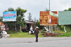 Crossing the highway (Roving I) Tags: conicalhats crossing highways caution billboards danang vietnam