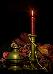 red candle (nadiaorioliphoto) Tags: red light candle stillife autumn leaves sfondonero interni pearls necklace vintage