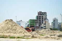 Pile of sand (Roving I) Tags: piles sand constructionsites hotels projects building architecture underconstruction diggers danang vietnam