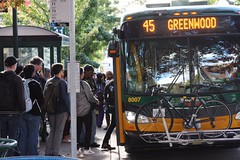 Getting on the bus on University Ave (Seattle Department of Transportation) Tags: seattle sdot transportation donghochang universitydistrict udistrict theave bus stop metro transit 45 loading people lots bike