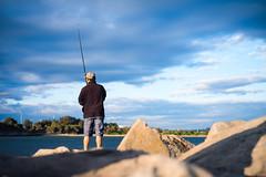(saddamqureshi) Tags: people blue sky fishing water streetphotography fujifilm 35mm