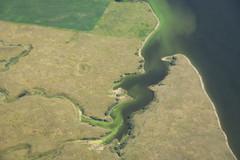 Fertilizer Leak (Ben_Senior) Tags: saskatchewan canada land landscape green yellow road water lake fertilizer wind windturbine bensenior flying flight aviation ppl pilot fly aerial prairies prairie nikond7100 nikon d7100