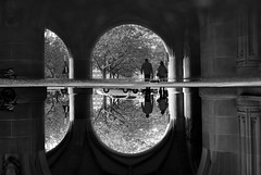 Parallel world (maekke) Tags: zrich reflection puddlegram architecture pointofview pov bw noiretblanc streetphotography man woman couple 2016 fujifilm x100t switzerland ch 35mm
