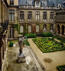 Inner court (Tigra K) Tags: paris ledefrance france fr 2016 architecture balcony city garden lattice museum plant sculpture statue vine window art