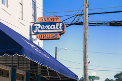 everyday distractions: unintended irony (jeneksmith) Tags: liberatemefromoppressiveheat complimentarycolors orange blue canon mississippi liberty drugs rexall sign building pharmacy neon awning south southern