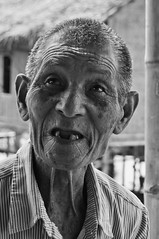 Still going strong (Tuk Tuk Tales) Tags: old travel portrait people bw man face closeup asian blackwhite nikon asia honeymoon locals village burma grandfather oldman monotone myanmar inlelake local dailylife burmese bnw d90 2013