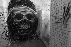Take a shower, the skull looks at you (Alexandre Dulaunoy) Tags: old bw streetart art abandoned shower skull graffiti noiretblanc creepy noirblanc urbex ttedemort sooc