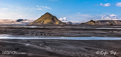 Mountain with river and sand in front