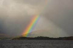 Intersection (intrepidscotland) Tags: mountain water rainbow background sunbeam lochlomond partial luss millarochybay