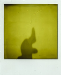 SX-70 Color Protection Film (Bravo213) Tags: shadow film yellow naked nude polaroid bare magic instant wisard